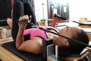 webmd_rf_photo_of_woman_using_reformer